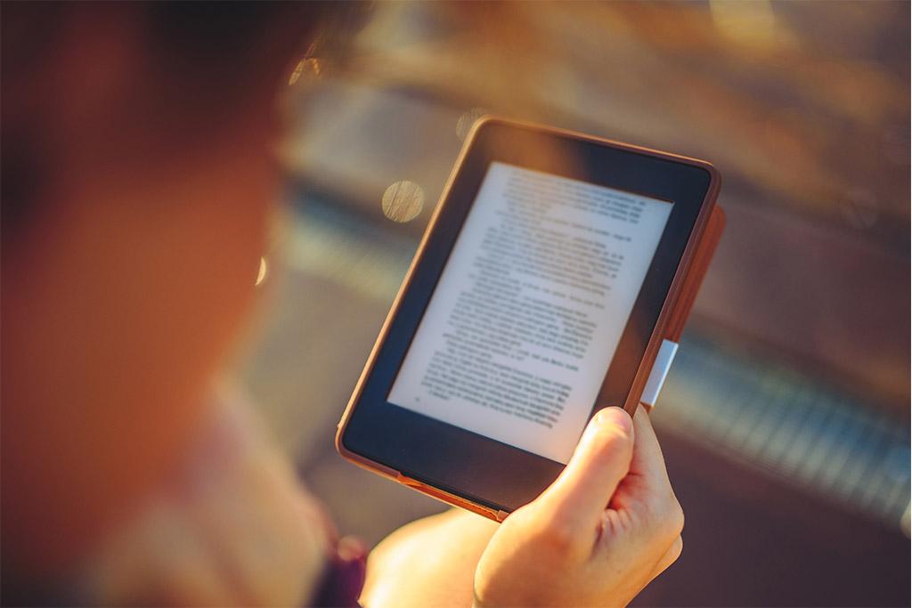A girl reading an e-book.