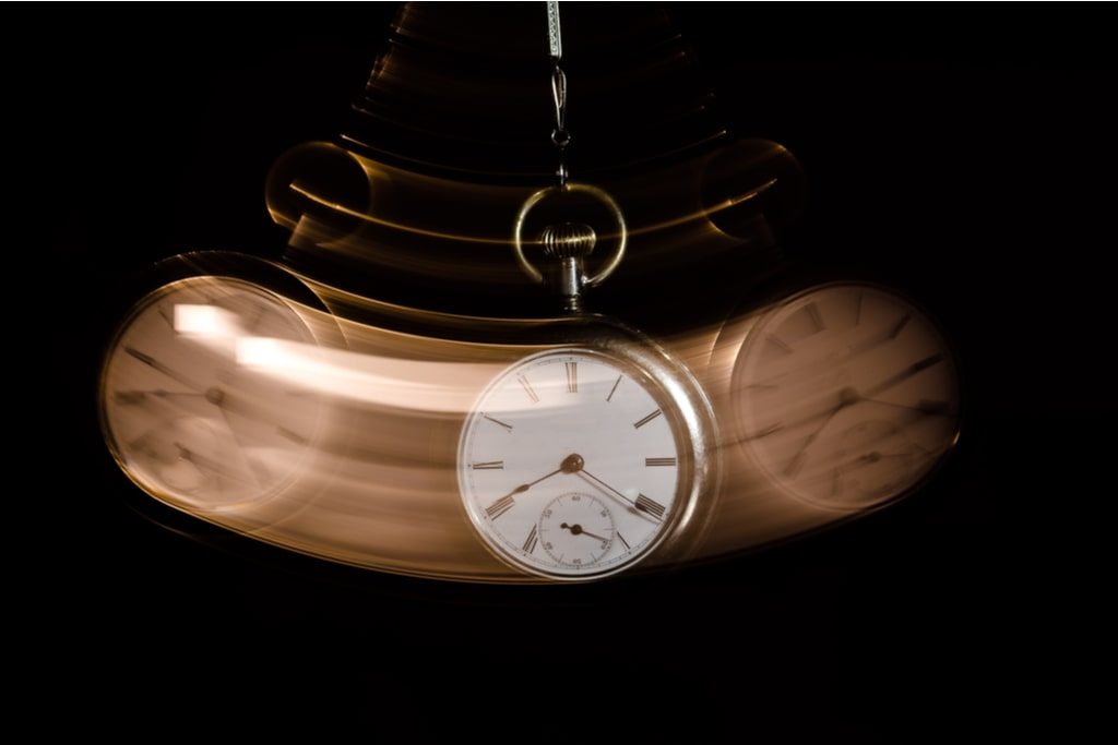 A clock moving back and forward.